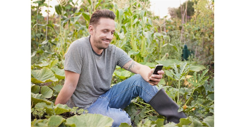 Man sitting on veg patch.jpg