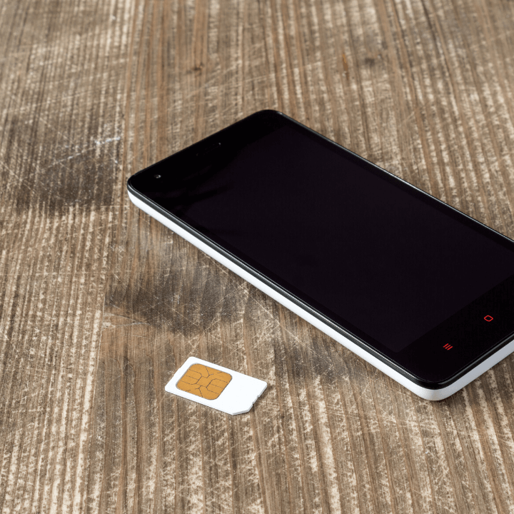 Mobile phone and SIM card on a table