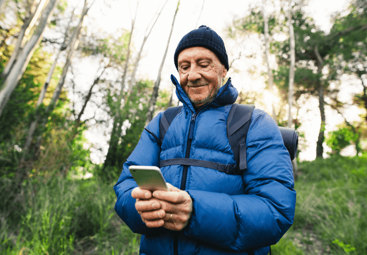Man on mobile in a forest